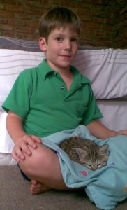 joshua sits with wild cat